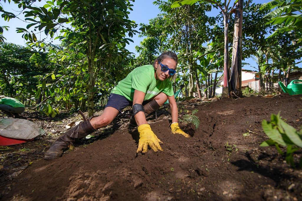 Planting trees on a slope? No problem for Kettle Produce's Susie McIntyre.