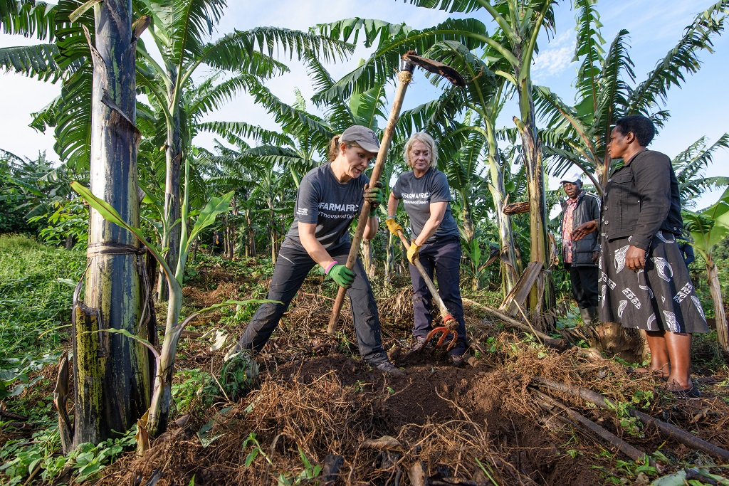 Michelle Burke of Devenish Nutrition (left) and Rachel Baldwin of Tulip planting trees as part of the Thousand Trees challenge in Uganda.