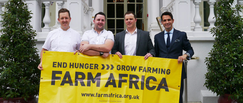 The team with Farm Africa banner at the Mandarin Oriental Hotel. (l to r: Ashley Palmer-Watts, Paul Foster, John Freeman and Paulo de Tarso)