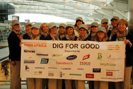 The team of diggers proudly display the banner showing all companies sponsoring Farm Africa's Food for Good campaign