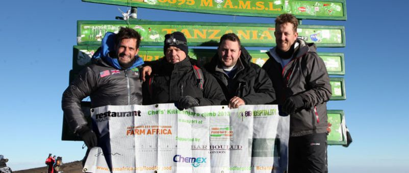 The chefs at the summit of Mount Kilimanjaro