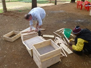 Matthew busy building a hive in Tanzania