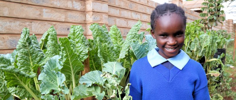 Primary school pupil Vallary, who is helping to grow nutritious vegetables for her school lunches.