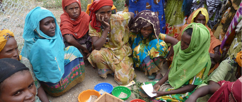 Women in Chacole going through the savings they have collected as a group.